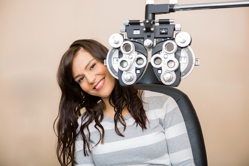 woman receiving an eye exam from her optometrist